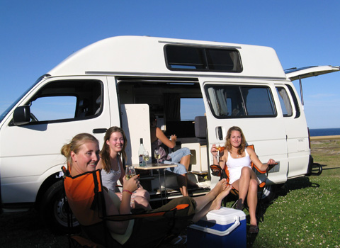fourGirlsOutsideCamper